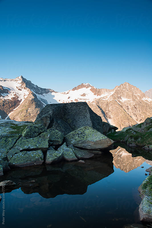Mountain lake at sunrise by Peter Wey for Stocksy United