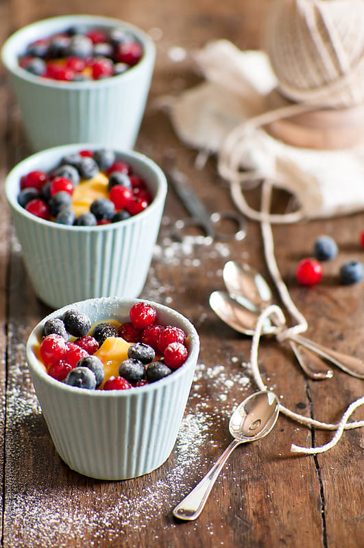 custard with currants and blueberries by Laura Adani for Stocksy United