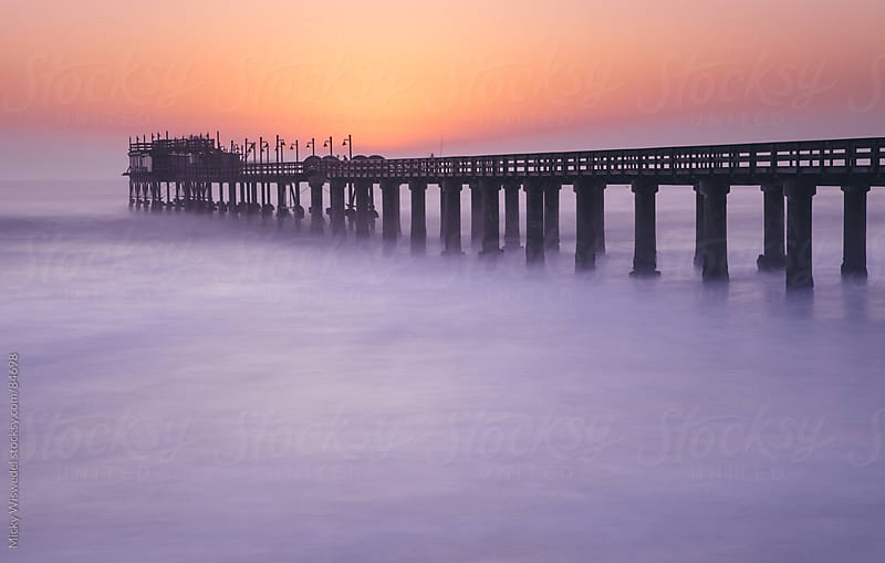 Long exposure of Swakopmund pier at dusk, Namibia by Micky Wiswedel for Stocksy United