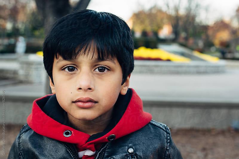 Cute stylish boy in a park by Gabriel (Gabi) Bucataru for Stocksy United