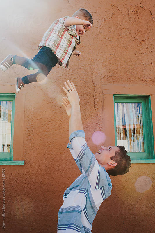 Dad Throwing Baby in the Air by luke + mallory leasure for Stocksy United