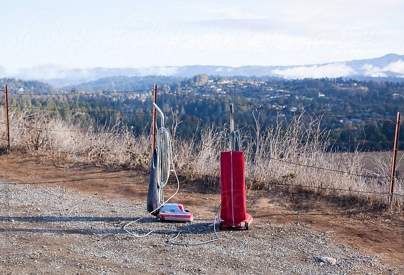 Abandoned vacuums enjoying the view by Carolyn Lagattuta for Stocksy United