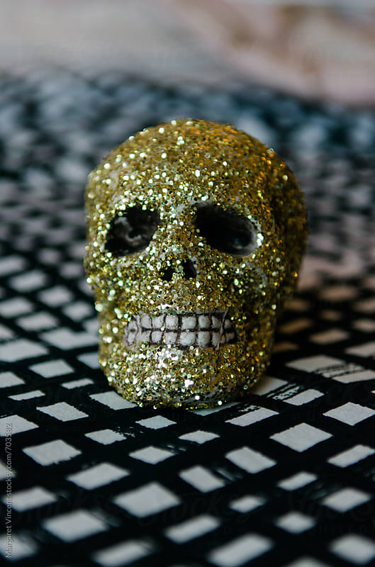 gold glitter skull by Margaret Vincent for Stocksy United