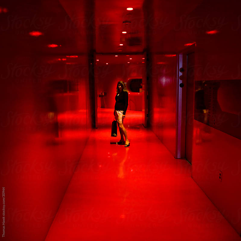 Woman in Red Room by Thomas Hawk for Stocksy United