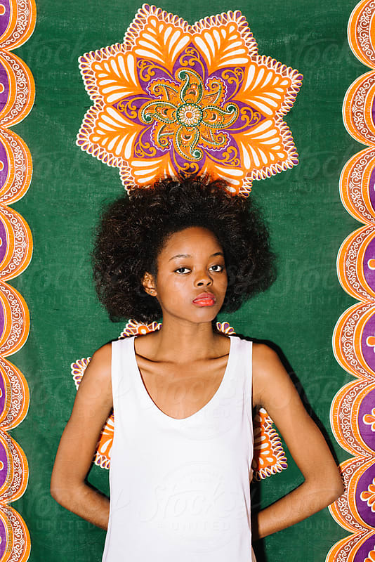 Woman with African Background by Bruce Meissner for Stocksy United