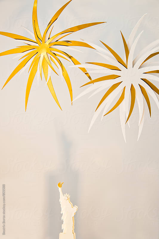 Stature of liberty with fireworks, all made of paper by Beatrix Boros for Stocksy United