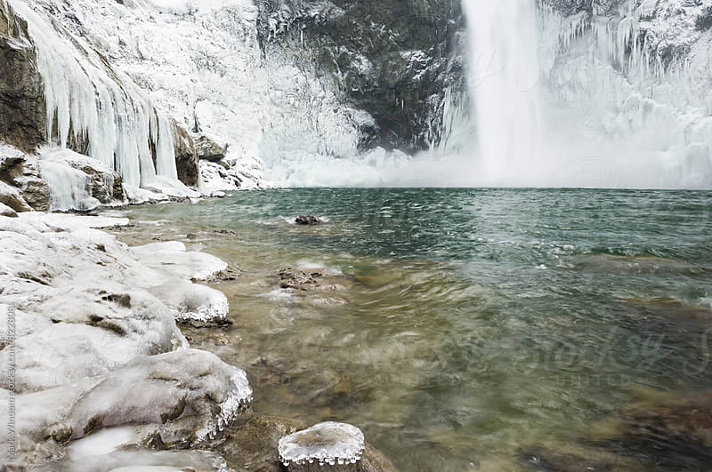 Waterfall and ice by Mark Windom for Stocksy United