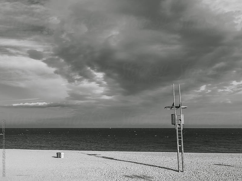 Lifeguard on Barcelona beach. Black and white photo. by BONNINSTUDIO for Stocksy United