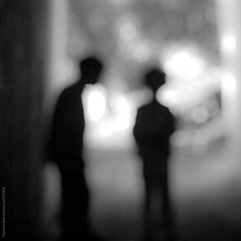 Two Children in Silhouette by Thomas Hawk for Stocksy United