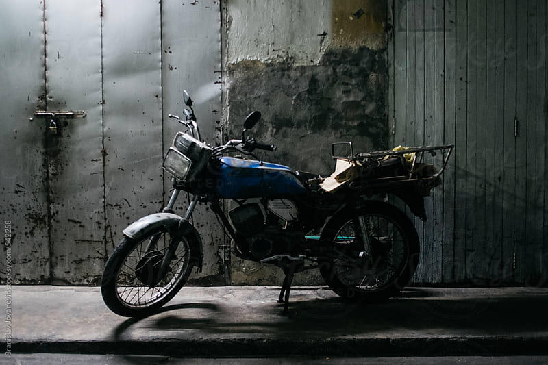 Retro motorbike on the street by Brkati Krokodil for Stocksy United