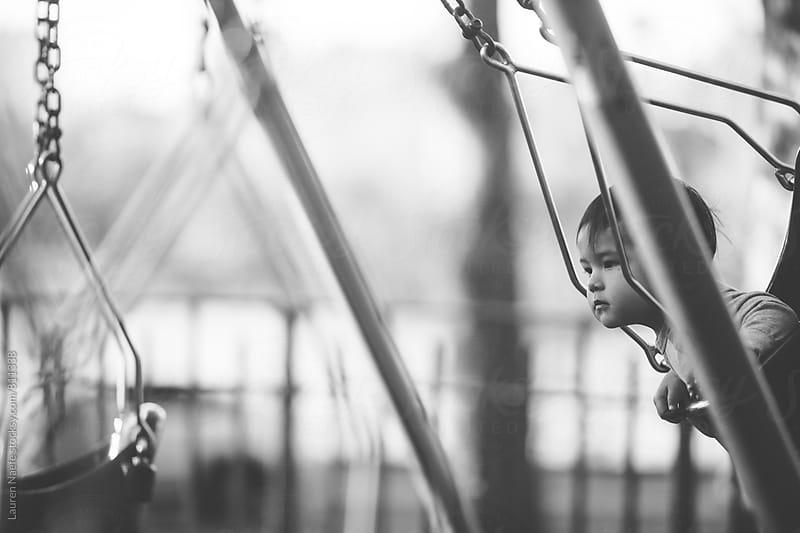 Baby on swings by Lauren Naefe for Stocksy United