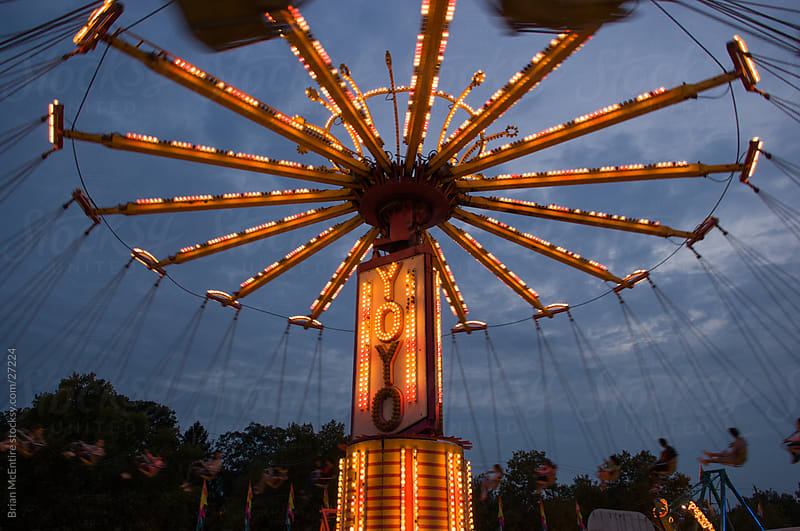 Carnival Rides at Dusk with Motion Blur by Brian McEntire for Stocksy United