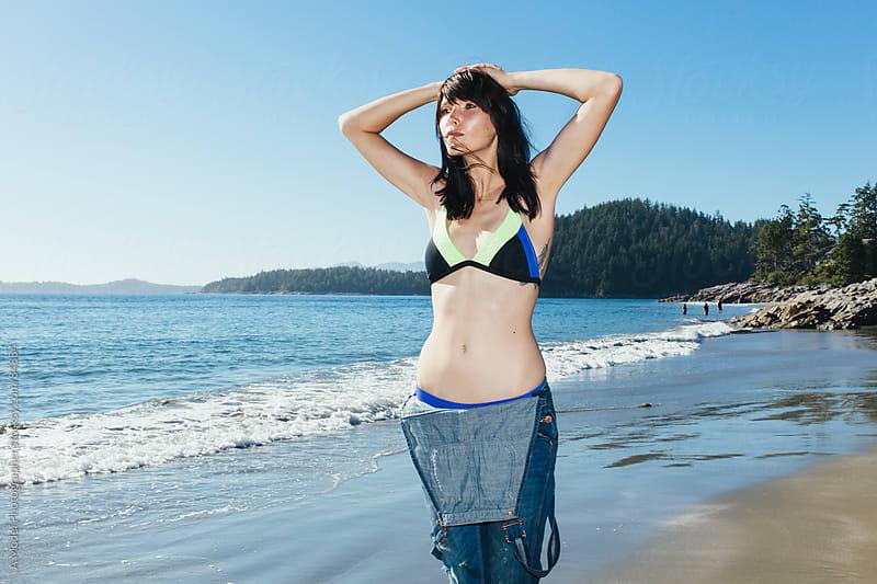 Beautiful girl in a bikini on the beach in Tofino, Canada by Ania Boniecka for Stocksy United