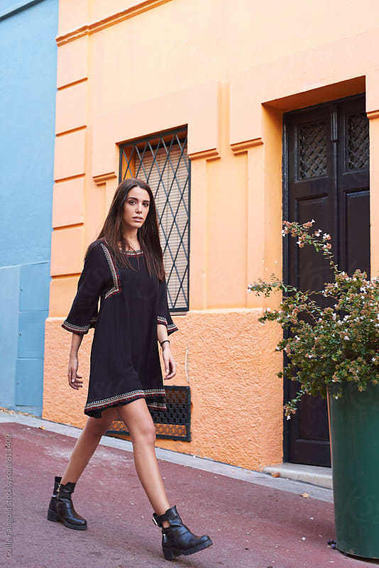 brunette woman walking on the city by Guille Faingold for Stocksy United