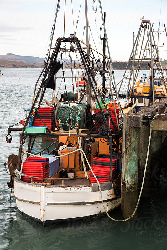 Commercial fishing boat at dock by Matthew Spaulding for Stocksy United