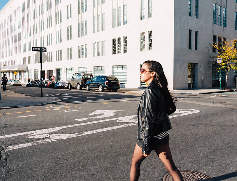 Attractive woman walking in New York City by Good Vibrations Images for Stocksy United