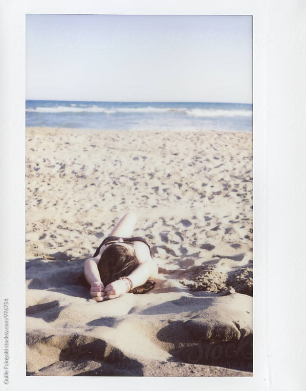 Unrecognizable woman in bikini on sandy beach by Guille Faingold for Stocksy United