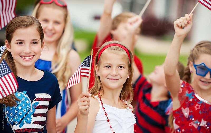Parade: Kids Having Fun in Neighborhood Parade by Sean Locke for Stocksy United