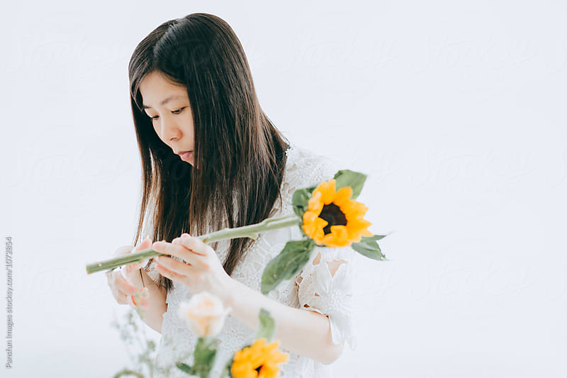 Woman arranging flowers by Pansfun Images for Stocksy United