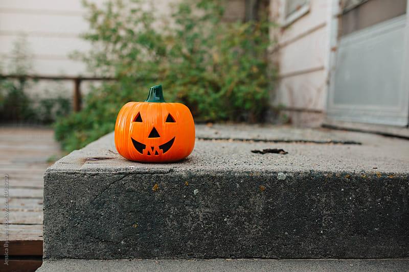 Pumpkin On Steps by Jessica Byrum for Stocksy United
