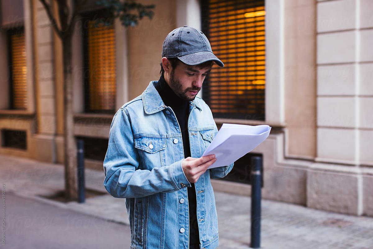 Actor reading script waking on the street. by BONNINSTUDIO - Actor, Student - Stocksy United