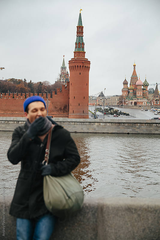 Man yawn in front of Red Square by Andrey Pavlov for Stocksy United