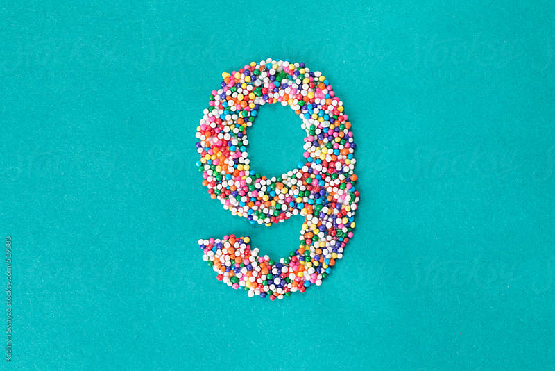 The number nine built from nonpareils by Kathryn Swayze for Stocksy United