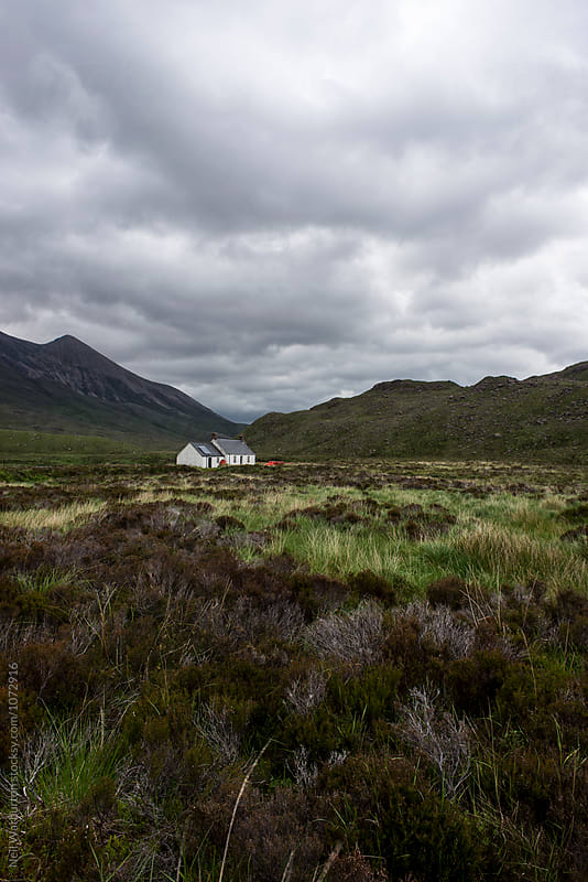 Remote cottage in a Scottish landscape by Neil Warburton for Stocksy United