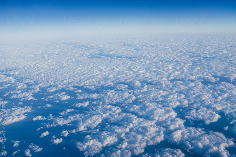 Clouds in the atmosphere shot from above by Micky Wiswedel for Stocksy United