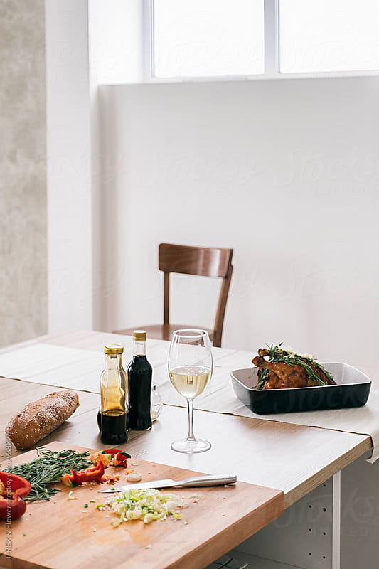 Still life of served dinner on table by Danil Nevsky for Stocksy United