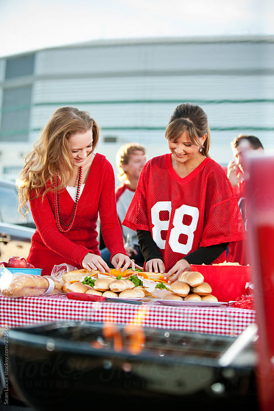 Tailgating: Women Help to Set Up Food for Party by Sean Locke for Stocksy United