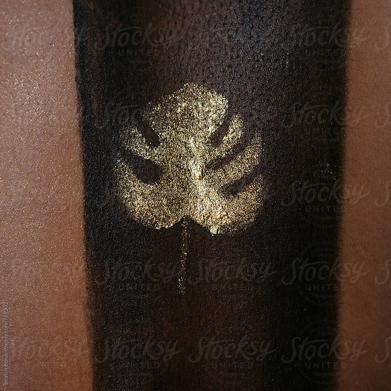 Palm leaf pattern painted on a human skin texture by Beatrix Boros for Stocksy United