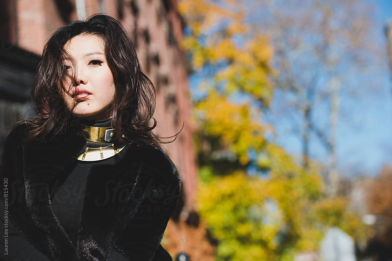 Stylish young woman in black fur coat by Lauren Naefe for Stocksy United