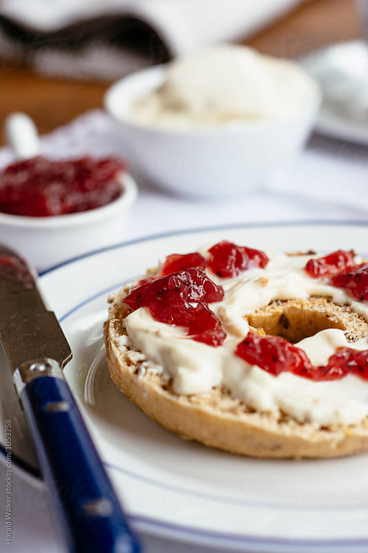 Bagels with jam and quark by Harald Walker for Stocksy United
