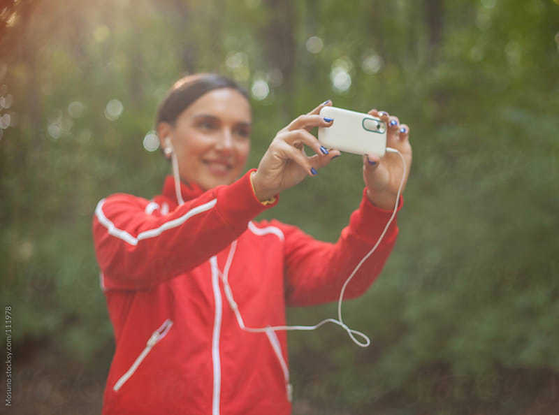 Woman Taking Selfie in Nature by Mosuno for Stocksy United