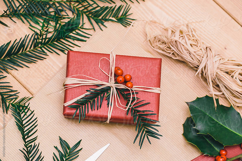 Wrapping Christmas gifts by michela ravasio for Stocksy United