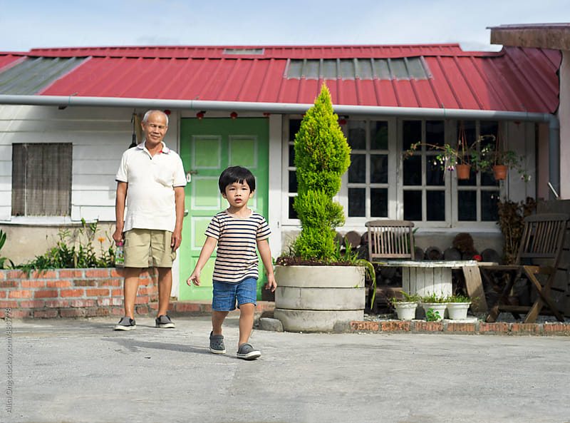 Grandpa and grandson at rustic country house by Alita Ong for Stocksy United