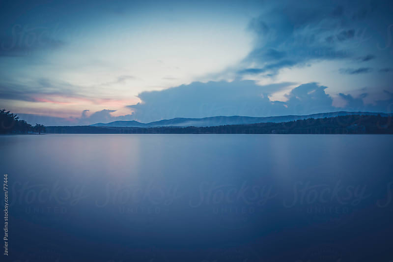 Blue sunset on a lake by Javier Pardina for Stocksy United