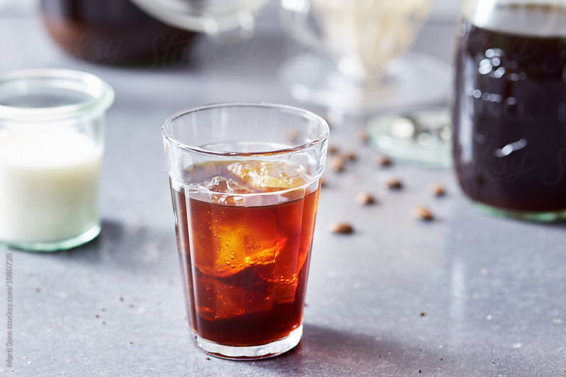 Ice coffee in glass by Martí Sans for Stocksy United