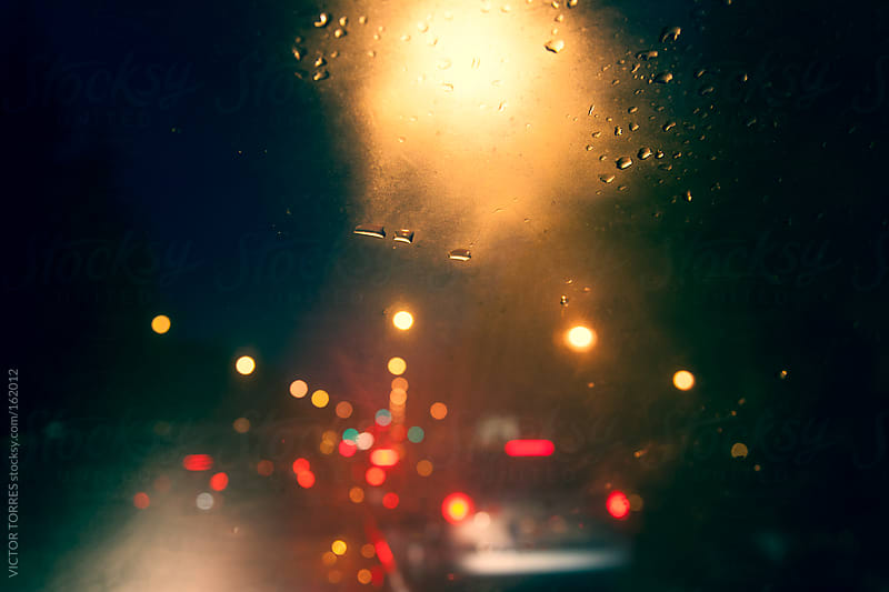Traffic Lights at Night by VICTOR TORRES for Stocksy United
