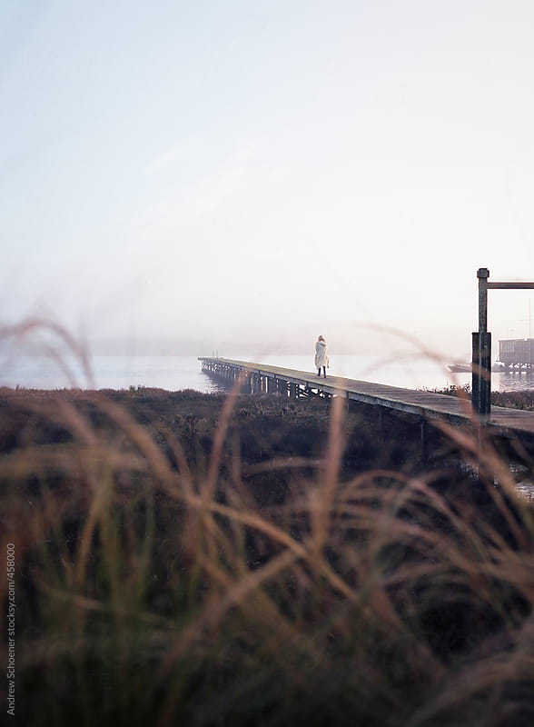 walking on pier by Andrew Schoener for Stocksy United