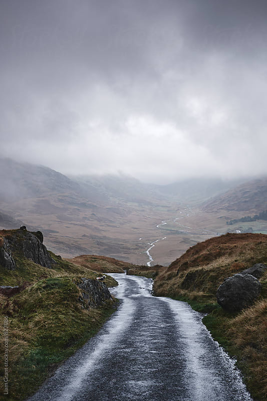 Rain clouds and road through the Wrynose Pass. Cumbria, UK. by Liam Grant for Stocksy United