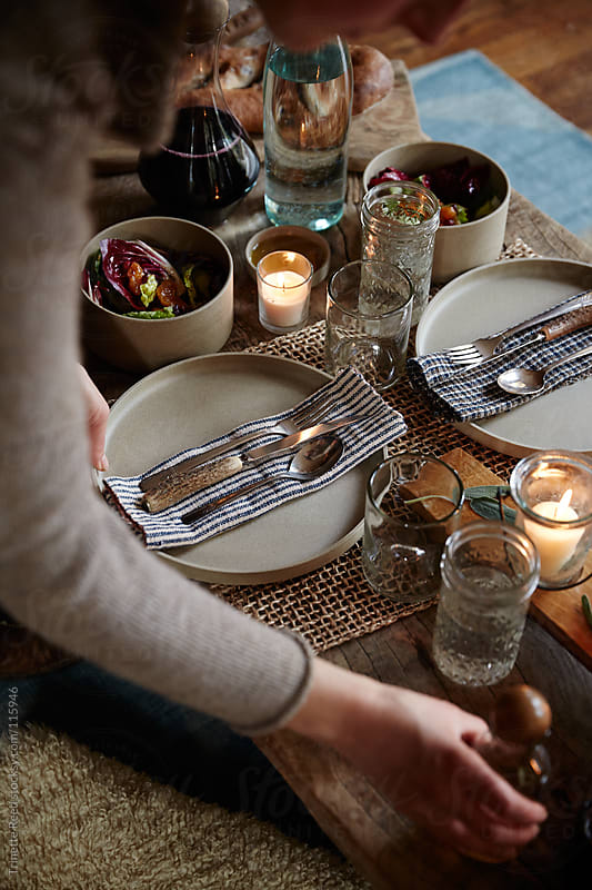 Woman setting the table for dinner party  by Trinette Reed for Stocksy United
