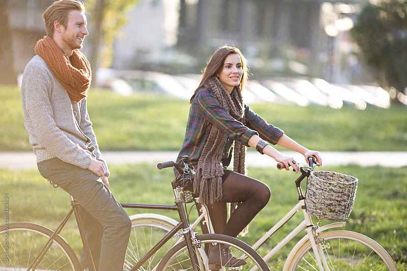Couple Riding Bicycles in Autumn by Lumina for Stocksy United