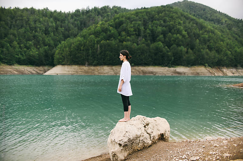 Brunette woman standing on the rock by Marija Kovac for Stocksy United