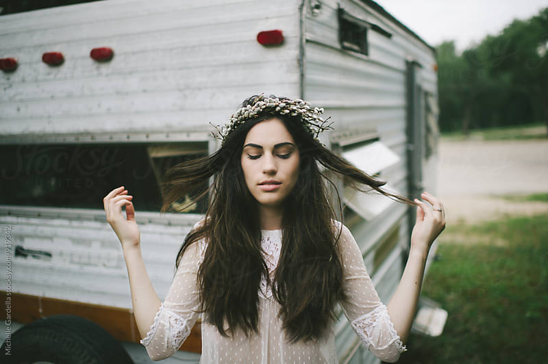 young woman and her camper by Michelle Gardella for Stocksy United