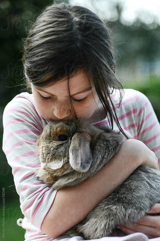 Girl kissing a rabbit by Kirstin Mckee for Stocksy United