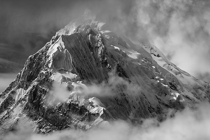 Clouds and high altitude mountain in black and white by Mick Follari for Stocksy United