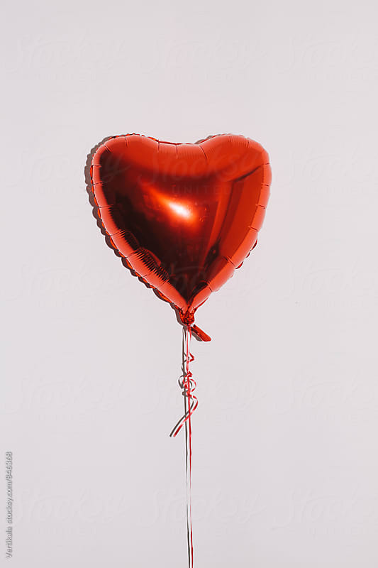Valentine's balloon in front of a white background by Marija Mandic for Stocksy United