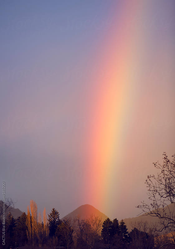 Colorful rainbow between the earth and the sky by CACTUS Blai Baules for Stocksy United